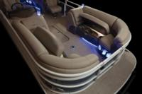 Wraparound bow lounges w/deep cushions, pillowtop backs, lumbar support, headrests, lighted lockable storage, lighted floor drink holders & 12V outlets