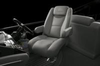 Oversized, adjustable, reclining swivel helm seat w/self-leveling arms & ventilated storage pouch on back