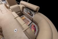Starboard aft lounge w/new Stow More™, deep cushions, pillowtop backs, lumbar support, lockable arm storage & drink holders