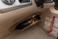 Flip-out console storage compartment