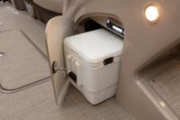 Below-console cooler storage space w/door. Shown w/optional cooler.