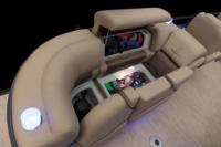 Port aft lounge w/new Stow More™, deep cushions, pillowtop backs, lumbar support, lockable arm storage & lighted drink holders
