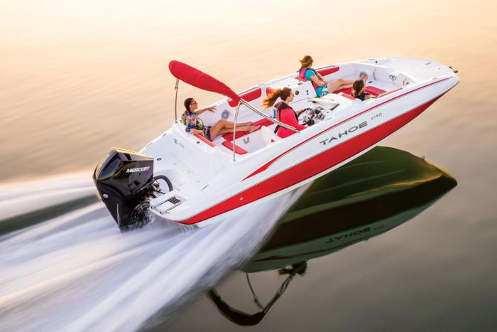 2019 Tahoe 2150 deck boat in red and white planing across the water
